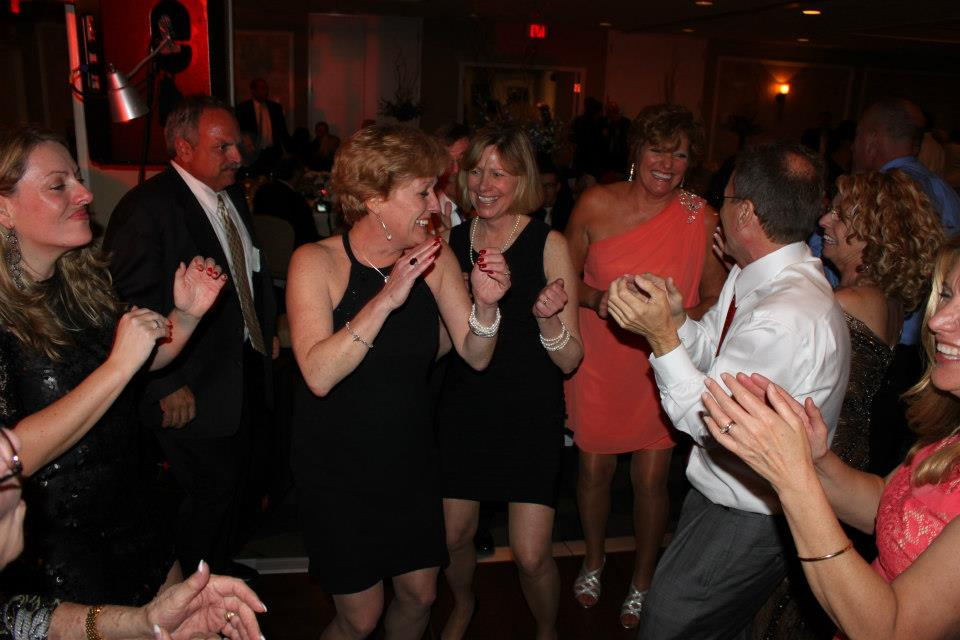 The Farrell clan in action at our cousin Amanda's wedding. As usual, Coleen is at the center of all the fun!
